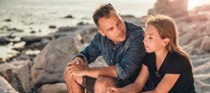 A father speaks to his daughter about alcohol use disorder