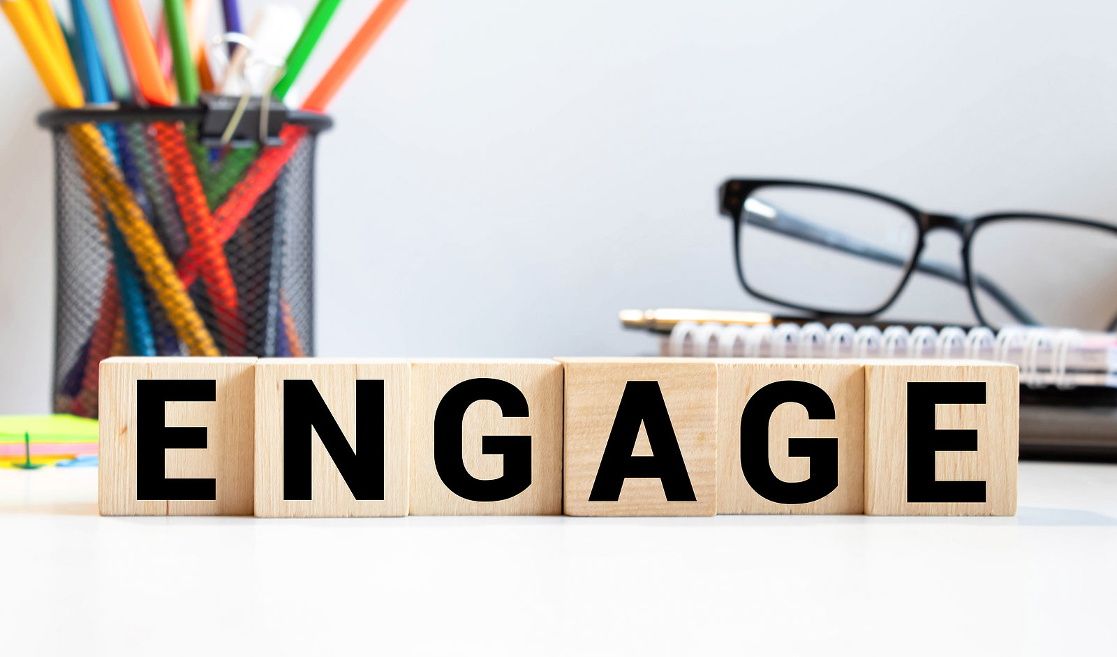 Blocks that spell out the word engage