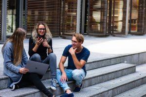 teens discussing red ribbon week ideas