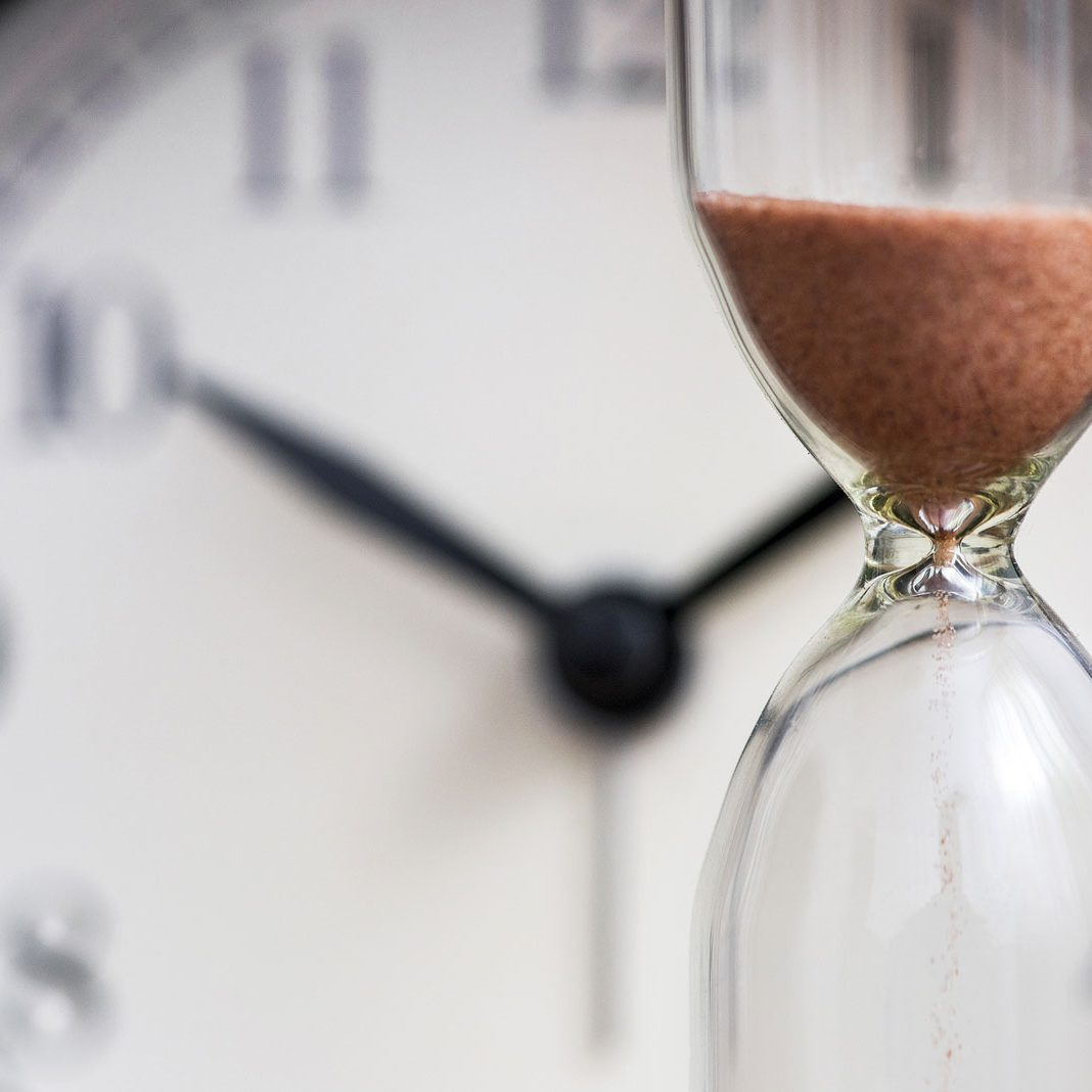 bigstock-Hourglass-On-The-Background-Of-391399700