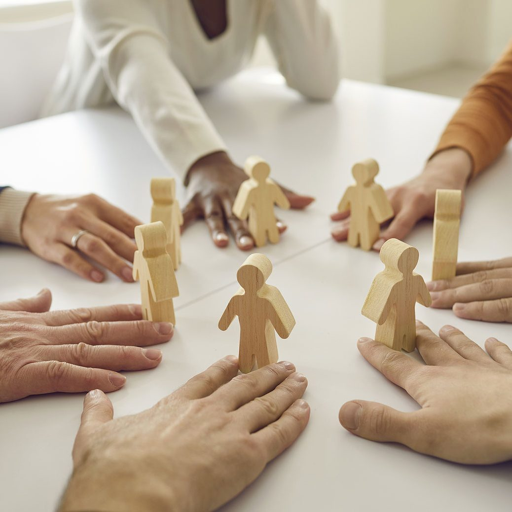 Hands on a table representing a team working together